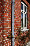 Brick house gutter window Royalty Free Stock Photography