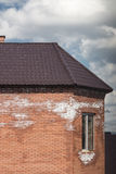 Brick house and salt on the wall. A fragment of a brick house and salt on the brickwork Royalty Free Stock Photo
