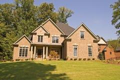 Brick House on Shady Hill Stock Photography