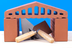 Brick house symbol and mason tools Stock Photo