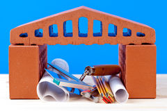 Brick house symbol and tools Stock Photos
