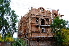 Brick house under construction Royalty Free Stock Image