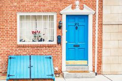 Brick house and vintage blue doors. Old town, Philadelphia, USA. Fragment stock images