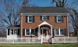 Brick House with White Picket Fence Royalty Free Stock Photos