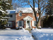 Brick House in Winter Snow Stock Photos
