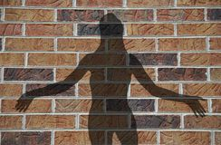 Brick house woman. The silhouette of a sexy welcoming woman against a brick wall Stock Images