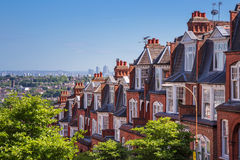 Brick houses of Muswell Hill and panorama of London with Canary Wharf, London, UK. Brick houses of Muswell Hill and panorama of London with Canary Wharf stock image