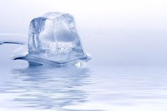 Brick of ice on blue Stock Photos