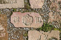 Brick with initials Stock Photography
