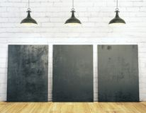 Brick interior with blank billboards. White brick interior with blank billboards illuminated with lamps and wooden floor. Gallery, frame, copyspace, exhibition Royalty Free Stock Image