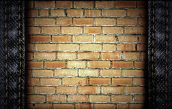 Brick and jeans background Stock Images