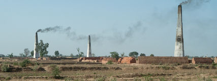 Brick kiln. S in Uttar Pradesh, India. Bricks are moulded by hand and then fired in Bulls continuous kilns like these royalty free stock photos