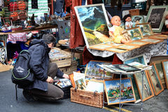 Brick Lane Antique Stall. London, UK - July 1, 2012:  Customers looking at antiques at a stall in Brick Lane, Whitechapel. On Sunday Brick Lane is home to one of Royalty Free Stock Photos