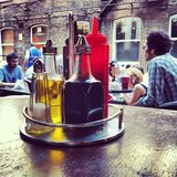 Brick Lane Cafe, London. Hipsters chat and dine at a cafe on London's Brick Lane E1 Stock Photo