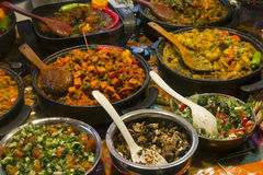 Brick Lane food. Impressive array of dishes at indoor food market in Brick Lane, East London Stock Photography