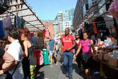 Brick Lane Market 3. Customers at Brick Lane Market in London. Excellent shot for tourist guides to the city Royalty Free Stock Image
