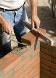 Brick layer. A brick layer putting down another row of bricks Stock Images