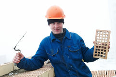 Brick layer worker builder mason. A brick layer worker building a brick wall at construction site Stock Images