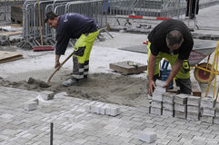 BRICK LAYERS. Copenhagen_Denmark_  08 August  2016-  Labour workers brick layer at corner kobmagrgade and norreport station   / Photo. Francis Joseph Dean/ Royalty Free Stock Image