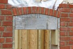 Brick laying building a brick arch royalty free stock photo