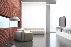 Brick living room, a sofa, a TV set and a poster Royalty Free Stock Images