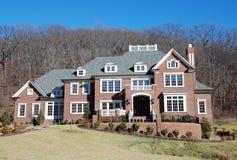 Brick Luxury Home 29. Brick mansion with multi-pane windows, chimney, and widow's walk Stock Photos