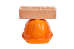 Brick lying on the protective helmet Royalty Free Stock Photo