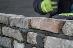 Brick mason laying old brick Royalty Free Stock Images