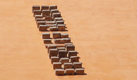 Brick masonry. In a background of a yellow wall royalty free stock photography