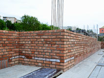 Brick masonry - construction site. Red brick masonry on house under construction Royalty Free Stock Photos
