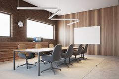 Brick and wood conference room interior. Brick meeting room corner with a glass wall and a long table with beige chairs. Ceiling lamps. 3d rendering mock up Stock Image