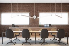 Brick meeting room interior. With a glass wall and a long table with beige chairs. Ceiling lamps. 3d rendering mock up Royalty Free Stock Photo