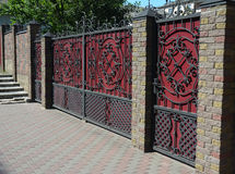 Brick and Metal Fence with Door and Gate of Modern Style Design Decorative Cracked Brick Wall Royalty Free Stock Photography
