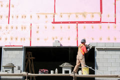 Brick and Mortar. Another brick being layed as a new big box retailer is being built stock photos