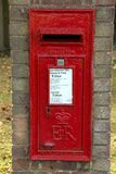 A brick mounted ER post box in a village royalty free stock photos