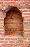Brick Niche. This photo is of a brick arched recess in a brick wall at Nalanda ruins in Bihar India. Nalanda Mahavihara was a large Buddhist monastery in the Stock Photo