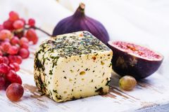 Free Brick Of Cow Milk Cheese With Herbs And Spices Royalty Free Stock Photo - 101948875