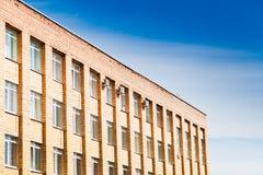 Brick office buildind under blue sky Stock Photos