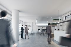 Brick office with a reception and columns, people. Modern office interior with a white reception counter, white walls and columns, large windows and an open Stock Photo