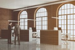Brick open space office, arch windows, people Stock Images