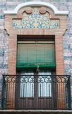 Brick ornament traditional window and balcony spanish style with stucco decoration. Traditional window and balcony in spanish style with stucco and plaster royalty free stock photography