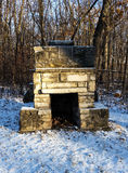 Brick outdoor fireplace in winter Royalty Free Stock Photo