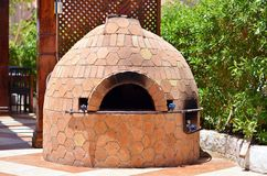 Brick oven for baking. Bread and pizza Stock Photo