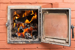 Brick oven with fire. Russian brick oven with fire close up Royalty Free Stock Photos