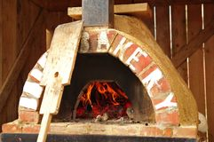 Brick oven. Outdoor traditional brick oven with exposed fire brick and domed ceiling Stock Photos