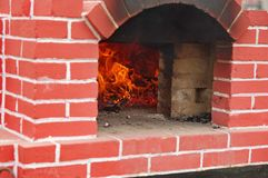 Brick oven 2. Outdoor traditional brick oven with exposed fire brick and domed ceiling Stock Photo