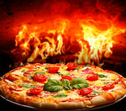 Brick oven pizza. Pizza margarita baked in a brick wood oven royalty free stock photos