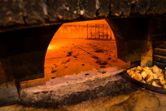 Brick oven in a pizza restaurant in Rome. Brick oven with flames and ember ready to cook a delicious pizza Stock Images