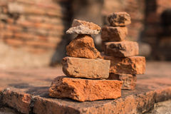 Brick pagoda. Many tourists from   Asia and Eurpoe have belief that bulding    in ancient temple at   Ayutthaya, Thailand, would make thier   life better Stock Photos