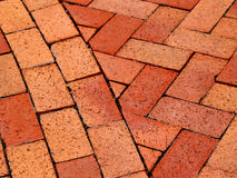 Brick Path. Curved and herringbone patterned brick walkway Royalty Free Stock Images